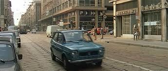 Viale Gorizia-Coni Zugna-Corso Genova 1971. Palazzo del COIN e una Fiat 127 100 GL (IMCdb.ord)